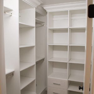 small walk in closet with crown and slab drawersweb