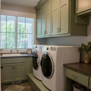traditional laundry green paitned cabinet custom riserweb