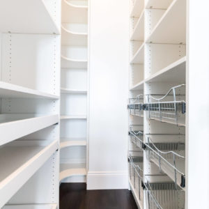 white melamine pantry with pullout shelves and wire basketsweb